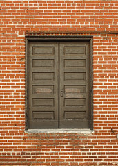 Brick wall / double doors (swampzoid) Tags: brick bricks wall door double unsafe industrial service wood wooden old architecture