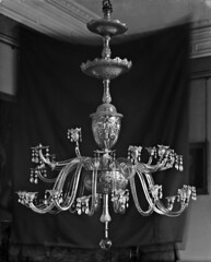 The Crystal chandeliers light up the paintings on the wall (National Library of Ireland on The Commons) Tags: ahpoole arthurhenripoole poolecollection glassnegative nationallibraryofireland waterfordglass cutglass waterford waterfordcrystal chandelier mayorsoffice waterfordtownhall