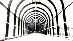 Underneath the Arches..... (markwilkins64) Tags: londonboroughofbromley london bromley theglades symmetry arches architecture walkway tunnel streetphotography street candid markwilkins dof depthoffield