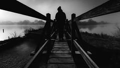 The Thinker (Matthew Johnson1) Tags: thinker misty atmospheric blackandwhite outdoors person silhouette water bridge lines
