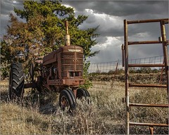 Another Fall Storm (A Anderson Photography, over 4 million views) Tags: farmall tractor farm canon clouds storm gate rust