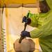 Tècnic d'emergències sanitàries del SEM passa a un maniquí per la línia de descontaminacíó en un simulacre de persona atesa per exposició al virus de l'Ebola