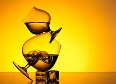 Balance (Karen_Chappell) Tags: glass liquid brandy orange yellow balance stilllife ice icecubes bubbles glasses glassware goblet goblets product