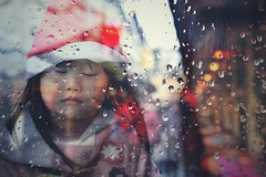 All I wish for Christmas is a better tomorrow ~ (~mimo~) Tags: holidays winter bokeh picture photography canon color netherlands valkenburg child girl rain drops market christmas