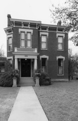 House — Lexington, Kentucky (Pythaglio) Tags: house dwelling residence historic twostory brick italianate sidepassage 11windows stone lintels hoodmolds incised cornice brackets friezevents doorway porch columns dentils balustrade trees sidewalk lexington kentucky fayettecounty