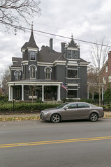 House — Lexington, Kentucky (Pythaglio) Tags: house dwelling residence historic twostory brick latevictorian eclectic queenanne 11windows roundarched hoodmolds parapet turret dormers cornice dentils porch columns ionic fence trees lexington kentucky fayettecounty