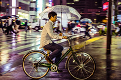 No fear of rain (Piotr_Lewandowski) Tags: rain street streetphotography cycle bike cycling commuting shinjuku tokyo japan japanese asia nippon urban umbrella dark night nightlights cityscape city candid movement