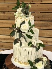 IMG_7989 (backhomebakerytx) Tags: texas back home bakery backhomebakery texasbakery cake wedding gold leaf asymetrical three tier weddingcake