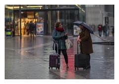 Conversation in the rain (AurelioZen) Tags: europe netherlands utrecht rain centre people interaction chatting
