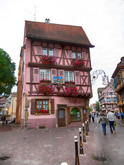 IMG_4758 pink house with stork nest decoration (pinktigger) Tags: house stork nest decoration balcony pink france alsace architecture colmar