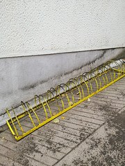Yellow and old metal construction for parking of bicycles in the city (shixart1985) Tags: abstract architecture autumn background bicycle bicycles bike biking broken building business city citylives cold construction contemporary cycle design dirty environment exterior group healthy indoors lifestyle nobody old parking rack safety street urban vintage yellow