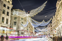 20191209_F0001: The Christmas angels are flying along the Regent Street (wfxue) Tags: london regentstreet city centre light christmas evening night trails traffic buildings people bus angels wings longexposure