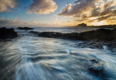 Bamburgh Backwash (captures.in.time) Tags: landscape landscapephotography northumberland england iconic le longexposure water rock ngm ngc photography seascape coastal coast beach rocks bamburgh castle sunrise northumbria