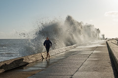 The jogger (Geoffrey Tibbenham) Tags: sea waves water weather winter wet storm promenade spray people pavement sky seascape seaside gunton suffolk lowestoft openspace outdoor jogger fuji xt2
