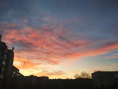 There will be wind tomorrow (elenakikiova) Tags: sunset red clouds sky window view urban