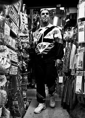 Adidas Man (Neil. Moralee) Tags: neilmoralee man trader market sports cloths addidas sale sales pafos paphos cyprus neil moralee male old mature black white mono monochrome blackandwhite blackwhite bw blackbackground candid olympus omd em5 trade work trainers track suite