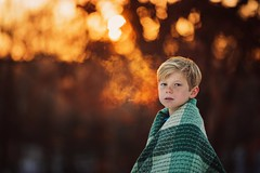 Oh winter sun, how I adore you! (Elizabeth Sallee Bauer) Tags: boy nature breath active blondhair beautyinnature orange sunlight white snow playing cold childhood fun outside outdoors golden evening kid child goldenhour goldenlight winter youth winterfun
