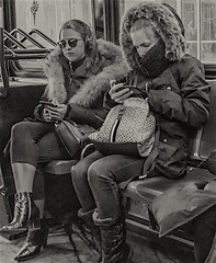 Candid of Young Ladies on 14A Bus in Manhattan (nrhodesphotos(the_eye_of_the_moment)) Tags: dsc23443001084 wwwflickrcomphotostheeyeofthemoment theeyeofthemoment21gmailcom portrait candid passengers bus monochrome urban autumn2019 glass metal transportation manhattan newyorkcity cellphones wintercoats prettygirls riding seated perspective reflections shadows textures youngladies mta