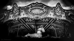 The Haunted Carousel After Closing Hours (JDS Fine Art Photography) Tags: bw monochrome carousel merrygoround carnival night cinematic dramatic supernatural haunted haunting spooky stormy stormysky