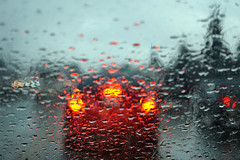 Glassy Rain (oats.raw) Tags: rainy day sonya6000 motorcycle cars traffic rain raindrops roof blue cold fall winter