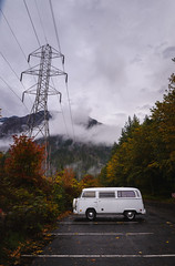 Lonely Camper (Ash and Debris) Tags: view autumn usa washington alone lonely nature van campground camper camping wet fall wood clouds woods trees forest weather wa wires colors tower car bus sky parking unitedstates electricity northcascades mountain travel