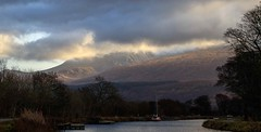 The sun fighting a losing battle (alangraham24) Tags: mountain scotland stormy clouds highlands weather