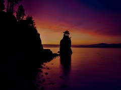 Siwash Rock just after sunset (World-viewer) Tags: dusk handheld twilight bluehour blue hour sea ocean marine beach beachbums siwash rock rocks seascape coastline seawalk stanley park vancouver beautiful evening night silhouette tree colourful color colorful iphone iphone8 iphone8plus plus ngc travel wander explore water landscape landmarks landmark award flickraward flickrtravelaward mbpictures