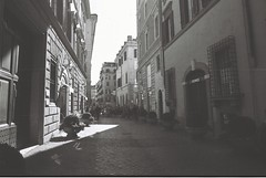 Roma (goodfella2459) Tags: nikonf4 afnikkor24mmf28dlens ilforddelta100 35mm blackandwhite film city streets road buildings roma italy rome bwfp