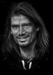 Portrait (D80_547866) (Itzick) Tags: candid copenhagen bw man beard face facialexpression blackbackground streetphotography portrait denmark d800 itzick