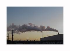 By going to work on foot (hélène chantemerle) Tags: matin ville ciel usine cheminées fumées evening city factory smoke chimneys