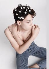 Lady Boy (camilarealini) Tags: nikon 50mm portrait studio white boy model flowers jeans pale skin dark hair curly