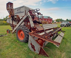 Allis-Chalmers Gleaner A Baldwin combine harvester, c1956 - Country Heritage Park, Milton, Ontario.. (edk7) Tags: olympuspenliteepl5 slrmagic8mm14rectilinearultrawideanglemanualfocuslens edk7 2017 canada ontario haltonregion milton countryheritagepark openairmuseum park ontariosteamantiquepreserversassociation osapa steamera2017 vintage classic sky word farming equipment farm agriculture rural country machine mechanical allischalmersgleanerabaldwincombineharvesterc1956 galvanizedsteel rust belt wheel tire sheetmetal steeringwheel fueltank chain selfpropelled corrugated