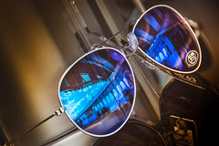 Look Closely (DobingDesign) Tags: glasses sunglasses reflections shiny mirror architecture pier brighton blue perceptions aviators spectacles eyeglasses seeing frame lenses lens colourful color colourpop lightandshadow blueglass detail victorianpier shopdisplay lookcarefully look
