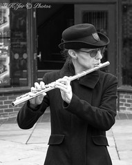 Sally's Flute Player-03359 (G.K.Jnr.) Tags: candid street streetphotography outdoor touristattraction interest people portraits strangers musician performers streetperformer fluteplayer flute livemusic music hat glasses spectacles monochrome bw blackandwhite blackwhitephotos urban london unitedkingdom fujix apsc xh1