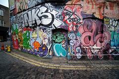 Two Red Cones and a Yellow Cone (weirdoldhattie) Tags: bristol stokescroft moonst moonstreet graffiti streetart art door doorway oneredconeandfouryellowcones yellowline cobbles urban