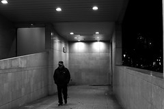 In the sinister corridor (pascalcolin1) Tags: paris13 homme man nuit night lumière light couloir corridor sinistre sinister photoderue streetview urbanarte noiretblanc blackandwhite photopascalcolin 50mm canon50mm canon