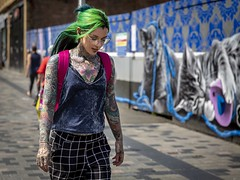 Artists' Canvas (Leanne Boulton) Tags: urban street candid portrait portraiture streetphotography candidstreetphotography candidportrait streetportrait streetlife juxtaposition art canvas woman female girl face expression mood emotion feeling tattoo bodymodification ink graffiti mural colourful green hair style fashion tone texture detail depthoffield bokeh alternative naturallight outdoor light shade city scene human life living humanity society culture lifestyle people canon canon5dmkiii 70mm ef2470mmf28liiusm colour glasgow scotland uk