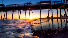 bi pier 2019--2 (kyleforemanphoto) Tags: pier waves ocean oceanscape water waterfront sea seascape seascapephotography sunrise sunset landscape landscapephotography nature oceanfront boardwalk travel destinations art fineart coast coastal reflections sand goldhour light sunrays