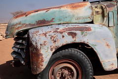 Abandoned In The Sand (peterkelly) Tags: digital canon 6d africa namibia capetowntovicfalls intrepidtravel namibdesert solitaire truck blue wheel tire sand hood derelict abandoned rusty rust rusted grill