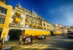 Elegant Hotel in Montreux, Switzerland (` Toshio ') Tags: toshio montreux switzerland europe european hotel grandhotelsuissemajestic swiss street crosswalk people city yellow car fujixt2 xt2 road architecture elegant