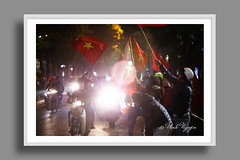 Fans celebrate when Vietnam crowns the SEA Games champions for the first time in the history. (Vinh.NT photos) Tags: u22 seagame asian soccer football fans crowed cheer celebrate vietnam hanoi flag national church night joyfull happyness