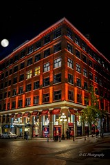 'Decked in red' -  Historic Gastown (Christie : Colour & Light Collection) Tags: red lighting leckiebuidling edwardianera warehouse factory historicdistrictofgastown 1908 1913 turnofthecentury nightphotography lowlightphotography gastown vancouver bc canada canadianhistory vancouverbritishcolumbia vancouverbc city cityofvancouver nightlights building oldbuilding waterstreetgastown waterstreet vancouverdowntowneastside moon streetphotography waterfron nationalhistoricsite placeofinterest downtownvancouver historiccoreofvancouver commercialbuilding outdoors nikkon nikon flickrphotography edwardianstyle architecture historicbuilding storefront windows night lunar luna exploregastown redandwhite