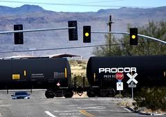 Stop for train (thomasgorman1) Tags: train tanker tracks light yellow stop crossing railroad rr nikon desert mountains trees arizona