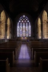 Prayerful (EricMakPhotography) Tags: church stainedglass pew symmetry model praying stetheldredas incidental people