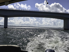 Boating Under a Beautiful Cloudy Sky (soniaadammurray - On & Off) Tags: iphone water sea waves ripples bridge light fence boat boating landing sky clouds shadows reflections exterior land seascape marte martedinubes martedidinuvole nwn