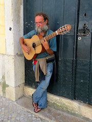 Lisbon street music (moonjazz) Tags: guitar music lisbon portugal fado buskar sing oldtown street male photography europe travel jeans scruffy entertain clasical acoustic melody song strum beard gray sandals hands artist