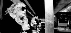 Be yourself. (Baz 120) Tags: candid candidstreet candidportrait city contrast street streetphoto streetcandid streetportrait strangers rome roma ricohgrii europe women monochrome monotone mono noiretblanc bw blackandwhite urban life portrait people provoke italy italia grittystreetphotography faces decisivemoment