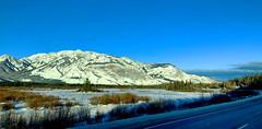 Jasper National Park: I love this view in any season! (peggyhr) Tags: peggyhr jaspernationalpark snow mountains forests island alberta canada img9989a sunlight shadows frozen cold blue white green clouds sky unhuman carolinasfarmfriends photozonelevel1