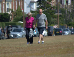 Couple on Lytham Green in Lancashire (Tony Worrall) Tags: street streetphotography urban candid people person capture outside outdoors caught photo shoot shot picture captured picturesinthestreet photosofthestreet welovethenorth nw northwest north update place location uk visit area attraction open stream tour photohour photooftheday pics country item greatbritain britain british gb buy stock sell sale dailyphoto ilobsterit instragram england lytham lythamgreen fyldecoast fylde