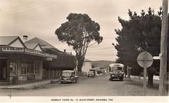 Main Street, Swansea, Tasmania - circa 1940 (Aussie~mobs) Tags: vintage tasmania australia rddilger mainstreet swansea bus car automobile vehicle shop grocerystore